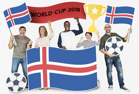 Diverse football fans holding the flag of Iceland