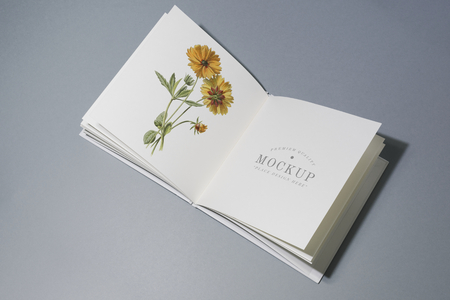 Mid fold book mockup with floral illustration