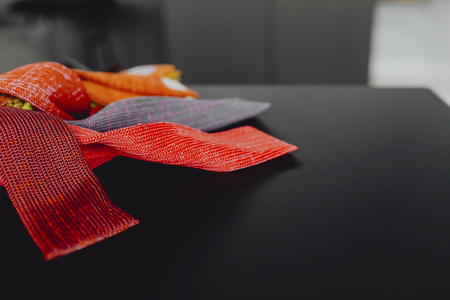 Closeup of textile samples on a black table