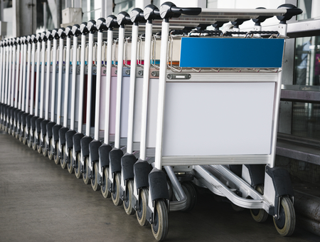 Luggage trolley at the airport with sign mockup Фото со стока - 112150546