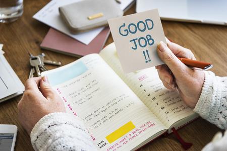 Hand holding Good job on a sticky note Stockfoto