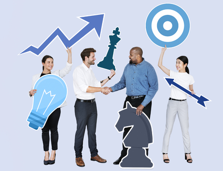 Happy business people holding business strategy icons Reklamní fotografie