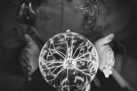 Little fortune teller with a plasma ball Banco de Imagens