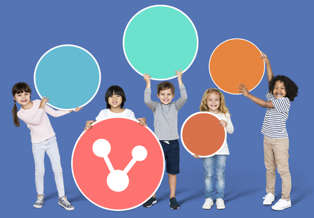 Diverse children with a sharing icon