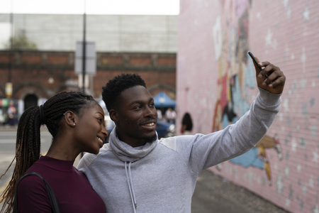 Couple taking a selfie in London