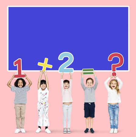 Cheerful diverse kids learning mathematics Stock Photo