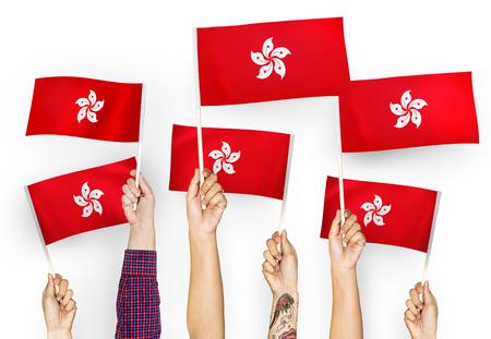 Hands waving flags of Hong Kong