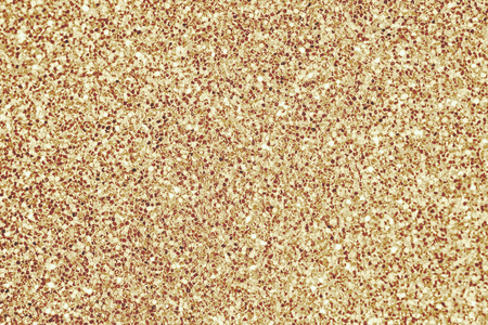 Close up of yellow glitter textured background Stock Photo