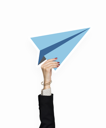 Hand holding a paper plane clipart Banco de Imagens