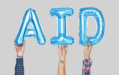 Hands holding aid word in balloon letters