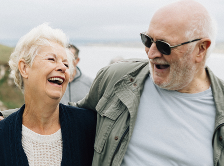 Happy elderly couple embracing each other