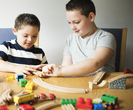 Brothers playing with blocks, trains and cars