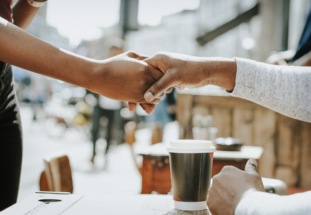 African couple shaking hands together