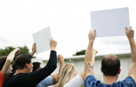 Rear view of activists showing papers while protesting Archivio Fotografico - 112593767