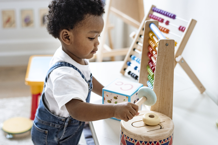 Young boy playing with educational toys Stock Photo