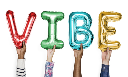 Colorful alphabet balloons forming the word vibe Foto de archivo - 112593889