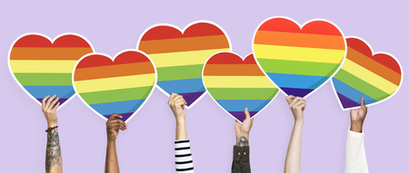 Hands holding a rainbow heart graphic Stock Photo