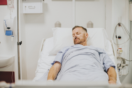 Sick man in a hospital bed