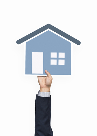 Hand holding a house icon clipart Stock Photo