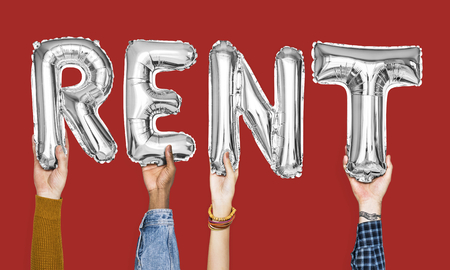 Silver gray alphabet balloons forming the word rent Standard-Bild - 112594667