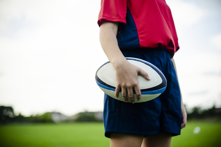 Female rugby player with a ball Stock Photo