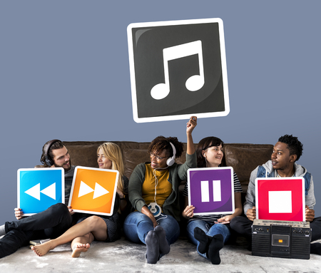 People holding media player icons and a musical note Stock Photo - 112594959