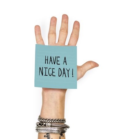 Hand showing a sticky note with Have a nice day