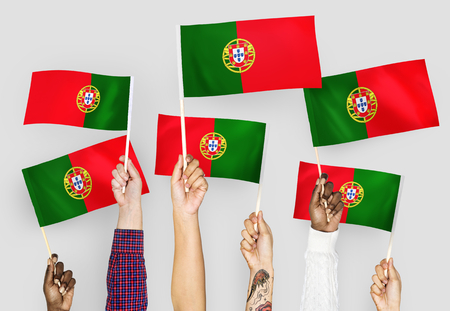 Hands waving the flags of Portugal 版權商用圖片