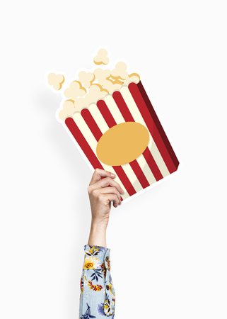 Hand holding a popcorn cardboard prop