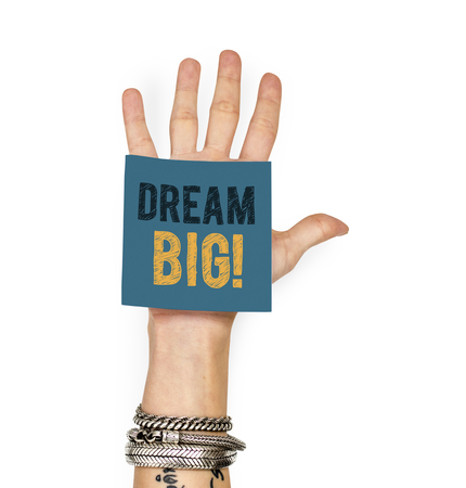 Hand showing a sticky note with Dream big Фото со стока - 112595281