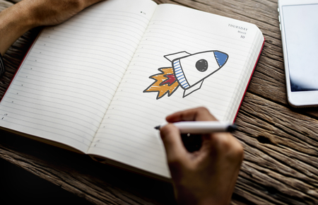 Rocket launch drawing on a notebook 免版税图像