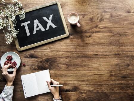 Tax written on a blackboard Stock Photo