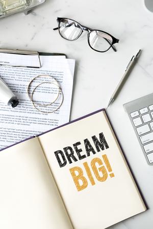 Dream big written on a notebook Фото со стока