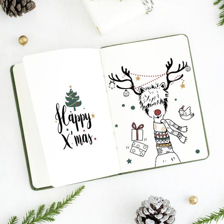 Christmas illustrations in a notebook mockup Stock fotó