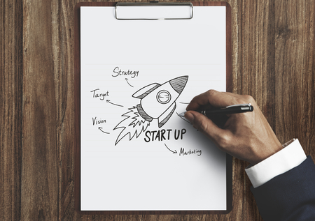 Businessman drawing a startup plan