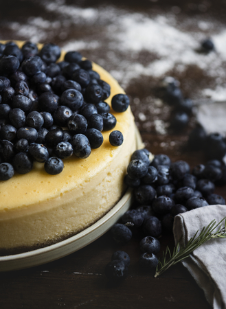 Closeup of a cheesecake decorated with blueberries Stock Photo