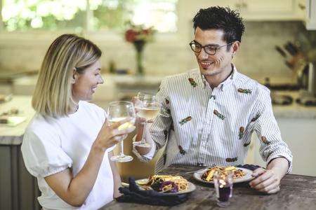 Couple having dinner in the kitchen
