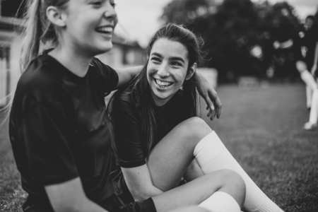 Female football players and friendship concept Stock Photo