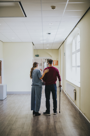 Physiatrist training a patient to walk again