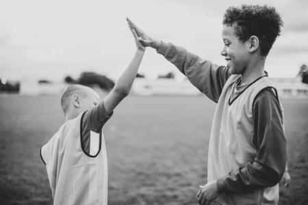 Junior football players doing a high five