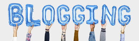 Hands holding blogging word in balloon letters