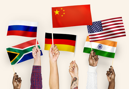 Hands waving flags of China, Germany, India, South Africa, and Russia Stock Photo