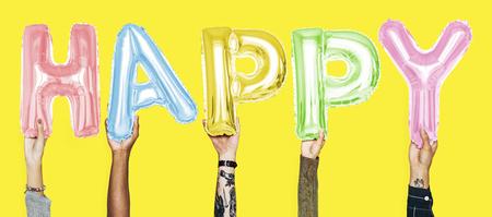 Hands showing happy balloons word Banco de Imagens