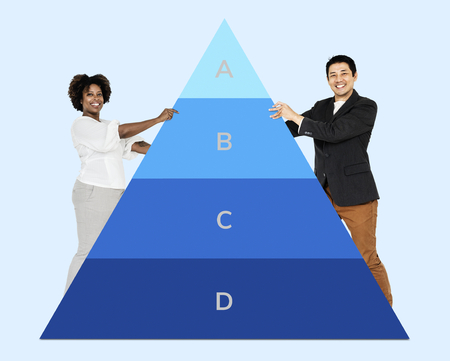 Man and woman holding a pyramid graph Stock Photo