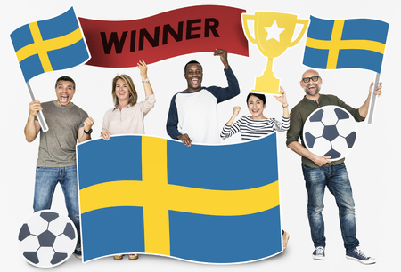 Diverse football fans holding the flag of Sweden