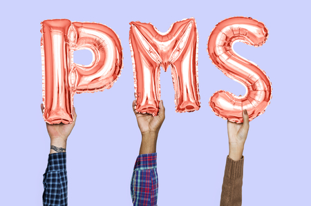 Hands holding PMS word in balloon letters
