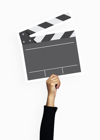 Hand holding a clapperboard prop