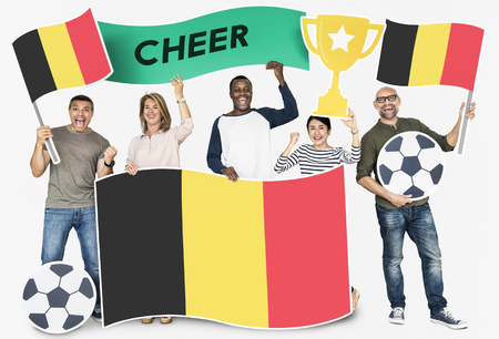 Diverse football fans holding the flag of Belgium