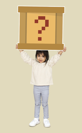 Little girl holding a question box