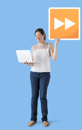 Woman carrying a fast forward button and a laptop
